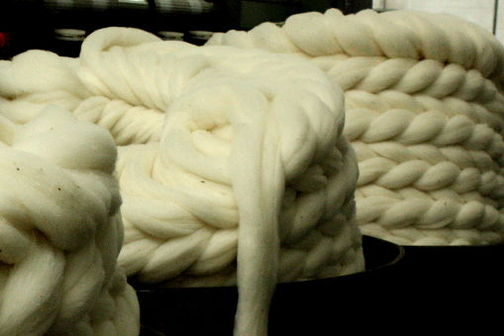 The wool has been through the scouring, carding, combing and drafting processes of the worsted system and is ready for spinning.